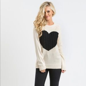 Cream color and black heart sweater size Medium